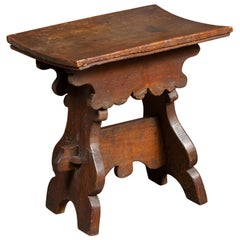 Rustic Italian 1800s Walnut Stool with Splaying Trestle Base and Carved Apron