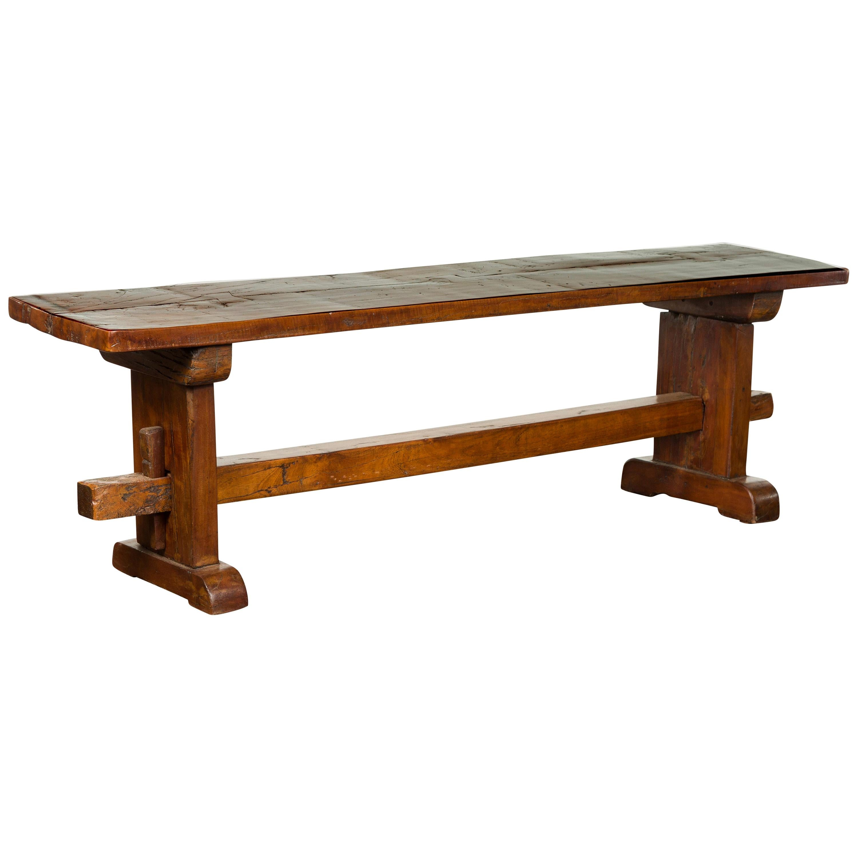 Rustic Italian Walnut Bench with Trestle Base from the Early 19th Century