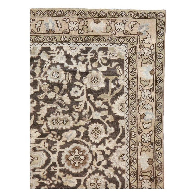 A vintage Persian Malayer accent rug in gallery format handmade during the mid-20th century with a rustic design in brown, slate, and cream tones.  Measures: 5' 2