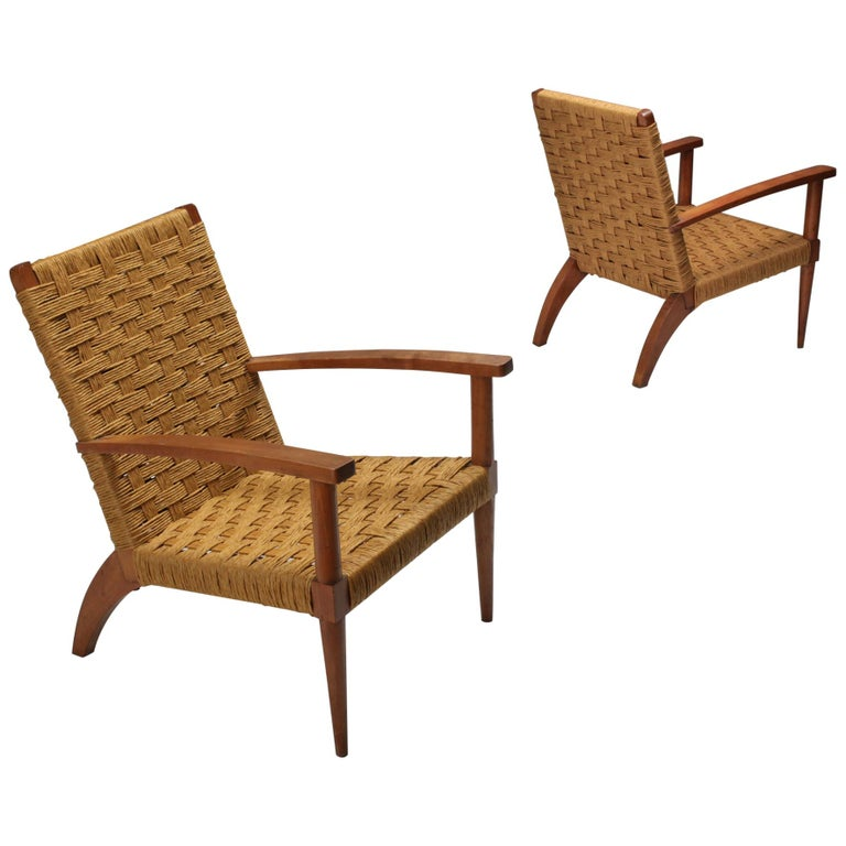 Mid-Century Modern pair of armchairs, Audoux Minet, France, 1960s  Rustic modern pair of French armchairs that would fit well in a naturalist wabi sabi decor. Beech and cord  Prijs per piece two chairs are available.