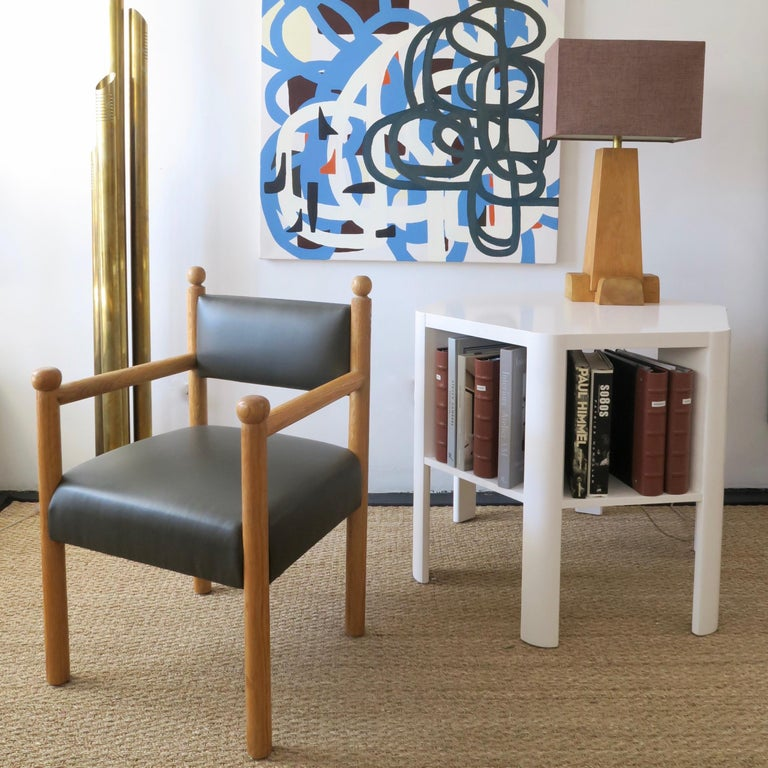 The Martin and Brockett Sydney chair has a wood frame with final details on the chair back and arm. Upholstered seat and back. Shown in scrubbed oak   Fabric is C.O.M. only - 2 yards  Other finishes available.