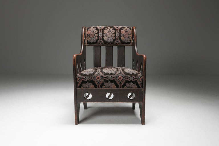 Early modern armchair, Sweden circa 1920, stained oak  Whilst the upholstery is more Expressionist, the general feel of the armchair is very rustic and sober. Like a piece from Axel Einar Hjorth upholstered in a weave by Märta