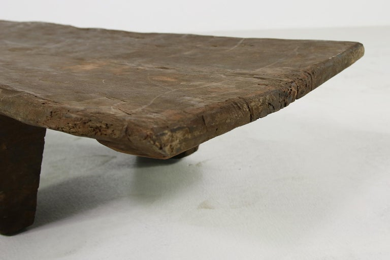 Beautiful and rare naga table, made of one piece of solid, hard, ancient wood. Completely hand carved, beautiful unique piece, super sturdy, possible to put everything on it, using it as a daybed or bench. Legs are not removable, as it's carved of