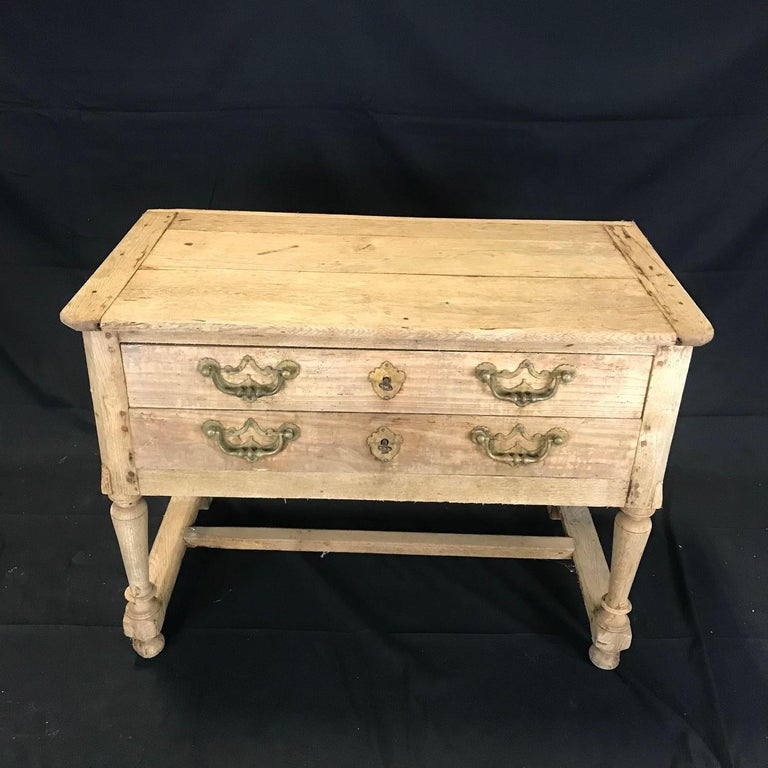 A charming unpainted rustic French side table or console having two drawers with keys.