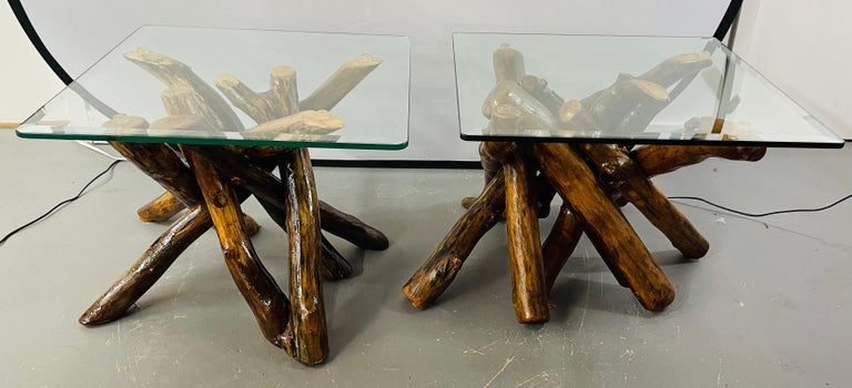 Side tables of reclaimed wood and bevelled glass top, a pair  A pair of rustic natural wood base side or end tables in an organic design fashion. This amazing pair of end or side tables feature veneered maple wood twist logs put together in an