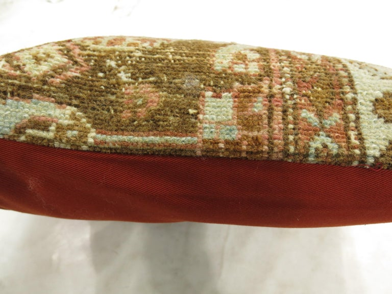 Pillow made from a Persian Malayer rug in rustic accents. Zipper closure and poly-fill insert included