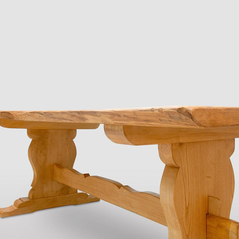 A superb addition to mountain or countryside cabin decor with the signature class of rustic, handmade furniture, this refined dining table is fashioned of solid chestnut. Each element is directly sourced from the barkless trunk and deliberately