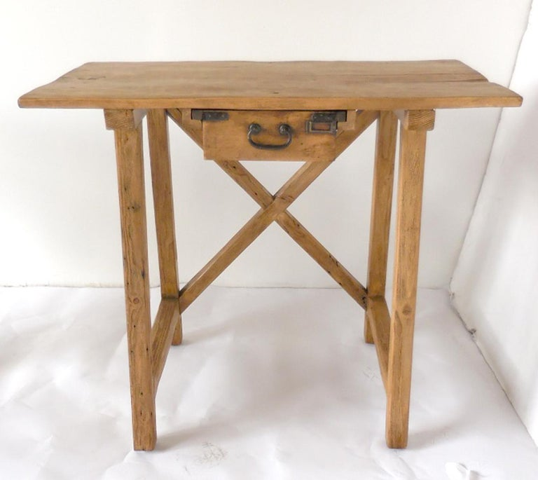 Table made from a variety of vintage wood with antique Japanese drawer with original iron hardware. These are sold separately. Finished in a light natural wood color. X-stretcher.