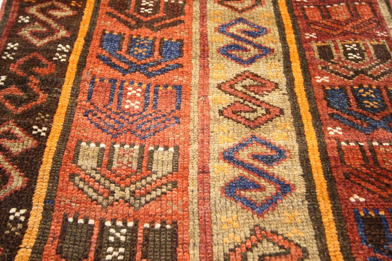 51712 Rustic Tribal Style Vintage Turkish Oushak Runner, Narrow Hallway Runner. Decidedly tribal and luxuriously mystical, this hand knotted wool vintage Turkish Oushak hallway runner features ancient symbolism in a repeat pattern along its length.