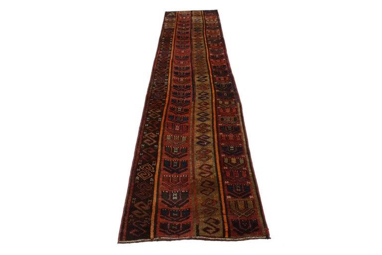 Wool Rustic Tribal Style Vintage Turkish Oushak Runner, Narrow Hallway Runner For Sale