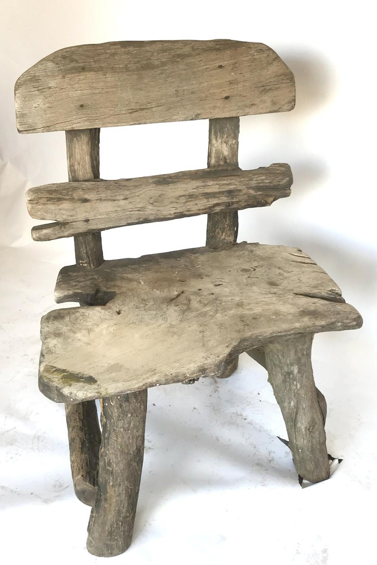 Vintage weathered oak garden chair. Great look, super sturdy. Would look great in a garden setting!