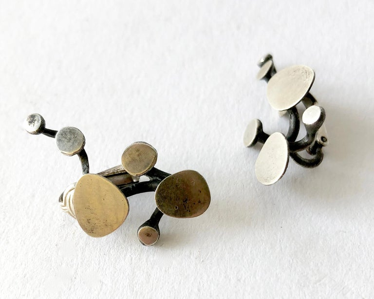 Sterling silver vine like earrings created by Ruth Berridge of New York, New York. Earrings are of the clip back variety and measure 1 1/4