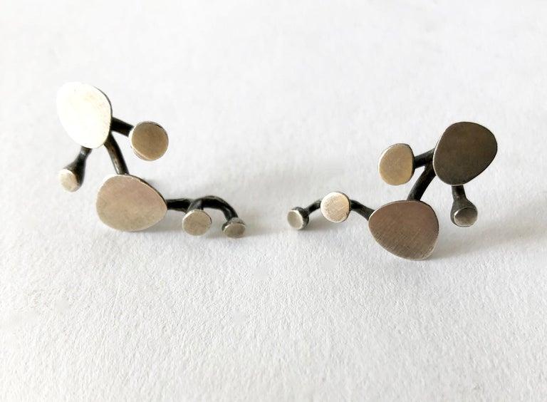 Sterling silver vine like earrings created by Ruth Berridge of New York, New York. Earrings measure 1 1/4