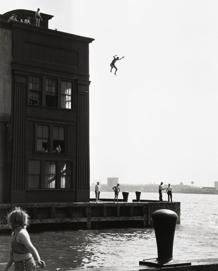 Boy jumping into Hudson River, NYC
