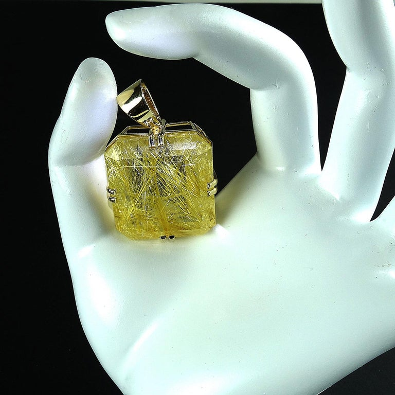 101.79 Carats of incredible golden Rutilated Quartz set in hand crafted 14kt yellow gold pendant.  This is a must have for all you collectors.  This unique gemstone is emerald cut and measures approximately 28x27mm. The Rutile is absolutely