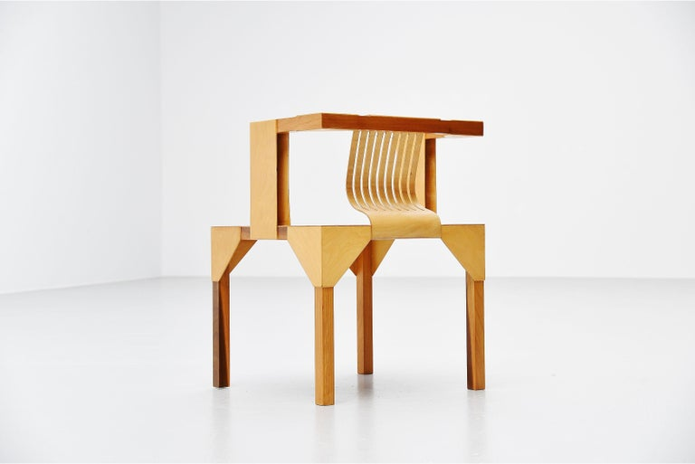 Very nice modernist slat chair designed by Ruud Jan Kokke, manufatured in his own atelier, Holland 1986. This chair is made of birch plywood and solid birch legs. It has a very nice woven seat and plywood back. Kokke was well know for its artistic