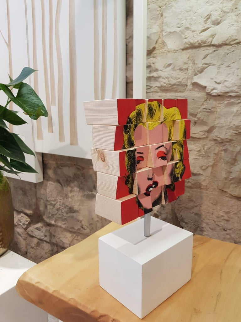 Marylin is an Original, Conceptual, Contemporary Art Piece.  Acrylic Paint on Canvas applied onto Wooden Blocks Personally Signed.  Each block is then painted with acrylic paint on Acrylic Paint on Cotton Paper. If miscalculated at any point of the