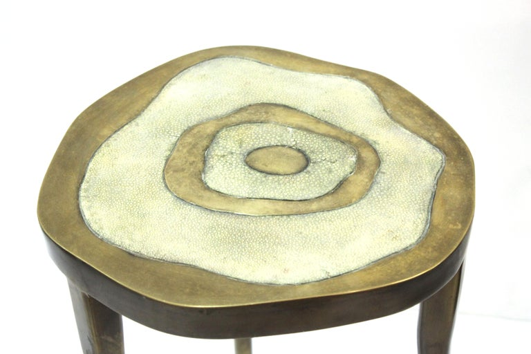 Modern Art Deco style three-legged side table in bronze patinated brass with a shagreen inlay top, designed and hand-crafted by Ria & Yiouri Augousti in Paris, France. Makers label plaque on the bottom. The piece is in great vintage condition with
