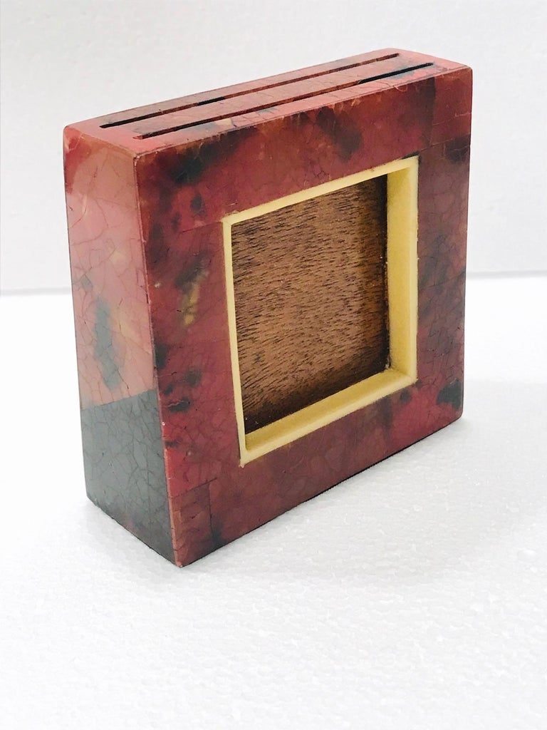 Vintage R&Y Augousti small double sided photo frame comprised of exotic handcrafted materials, circa 2000. Petite frame features a square tapered form with pen-shell inlays over palm wood frame. Lacquered and hand-dyed in mosaic red and black with a