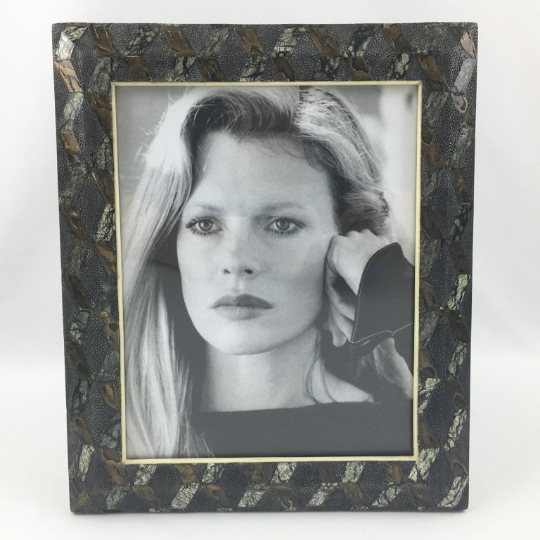 Elegant large picture photo frame designed and produced by famed decorative arts design firm Ria & Youri Augousti, Paris. Geometric marquetry with black shagreen, textured brass and black and white marble with bone accents. Marked at the back: