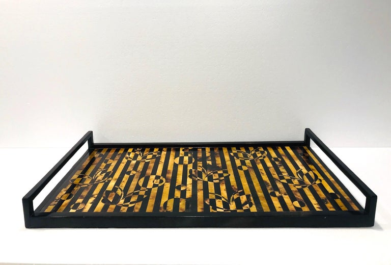 Organic modern decorative serving tray by R & Y Augousti. All handcrafted in fine exotic materials featuring lacquered and hand-dyed pen shell over a wood frame. Rectangular tray comprised of shell inlays in a series of stripes in tones of black,