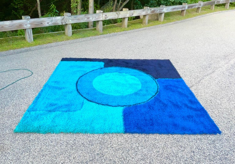 Deep dense 100% wool shag pile square rya rug produced in Denmark circa 1965 by Dania Taepper in an abstract collage of contrasting blues.  Measures: 98
