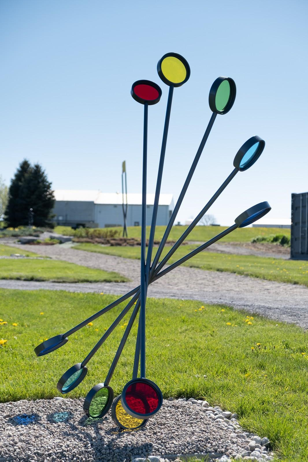 Action - tall, dynamic, rainbow colours, abstract, steel and glass sculpture