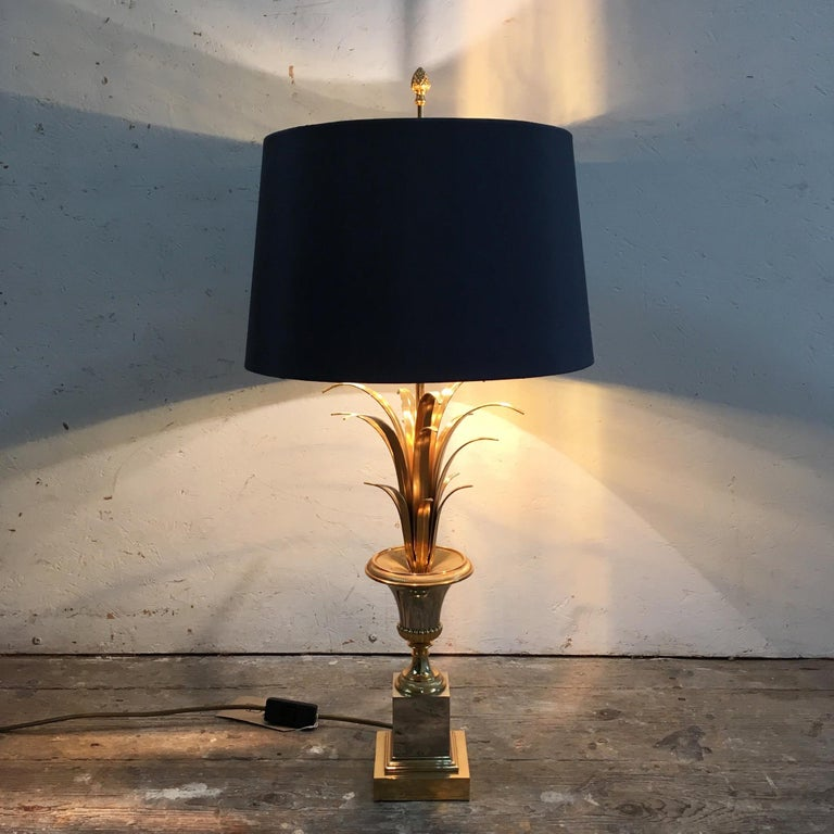 S A Boulanger table lamp  Gold and silver lamp base with gold fronds  The light takes two screw in bulbs E14  The top of the stem has the Classic Boulanger pineapple finial   The shade is a modern replacement, this is in a dark graphite grey