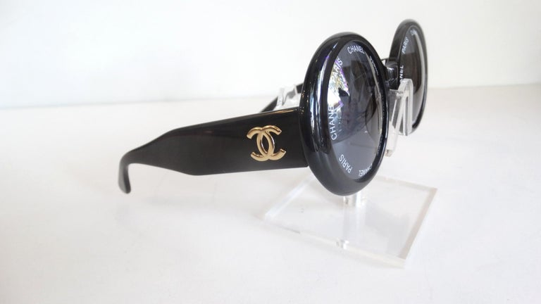 Your Everyday Sunglasses Are Here! From the Spring/Summer 93' collection, these black circle frame Chanel sunglasses feature