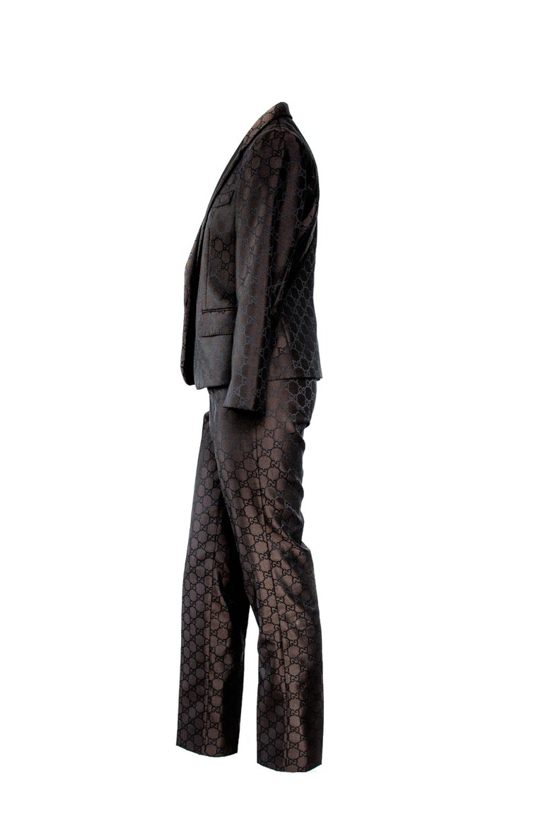 The RealList presents: Rare Gucci brown GG monogram pantsuit set. The black version of this woven GG print was prominently displayed on multiple looks during the S/S 1998 Gucci runway. The suit features hidden-button closures throughout and a