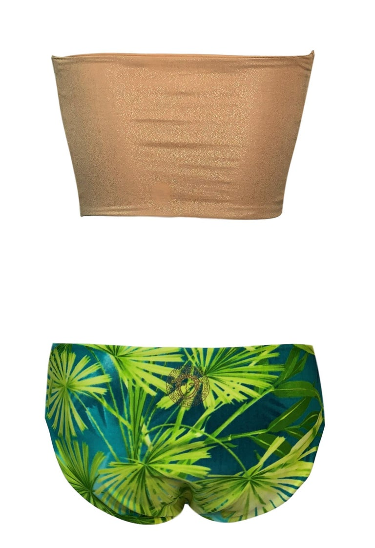 DESIGNER: S/S 2000 Gianni Versace - Bikini & wrap skirt  Please contact for more information and/or photos.  CONDITION: Good- overall excellent  with no flaws but there is one very minor factory imperfection in the back of the top where there is an