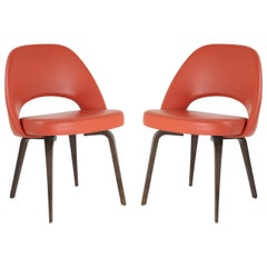 Saarinen Executive Armless Chairs in Burnt Orange Leather and Walnut Legs, Pair
