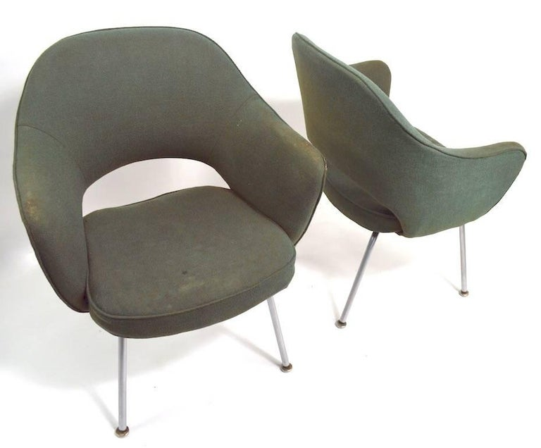 Saarinen design Executive chairs by Knoll. Two available, both will need to be reupholstered as the fabric is worn, and the foam crunchy. Timeless modern design, great form, ready to restore and enjoy. Arm H 25 inch x Seat H 16. Priced and offered