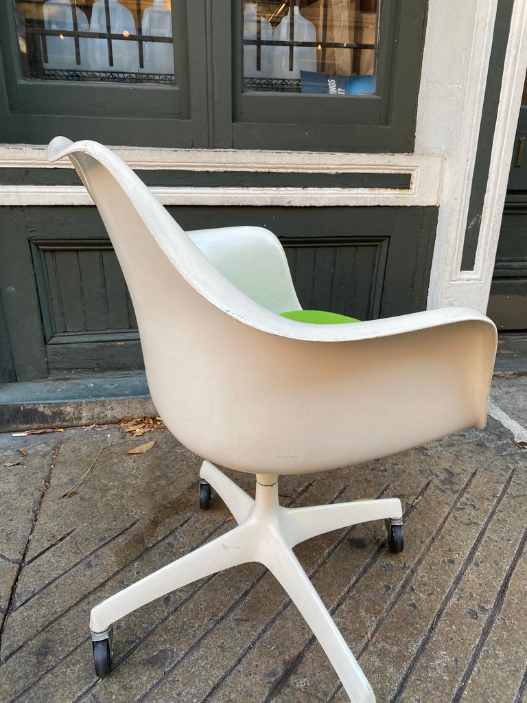 Saarinen for knoll executive desk chair. Rare and uncommon form. Chair produced in 1964 only! Classic tulip design with a rolling base. Retains original label. Chair upper shell has been painted at some point in it's life. Old paint that adds to the
