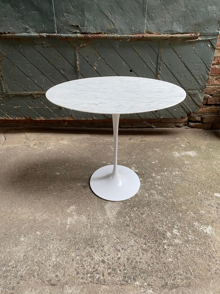 Eero Saarinen for Knoll ovoid white marble top tulip base end table. White bevel edge marble with gray veining. A nice example originally purchased in 1968.   The oval marble top measures 15