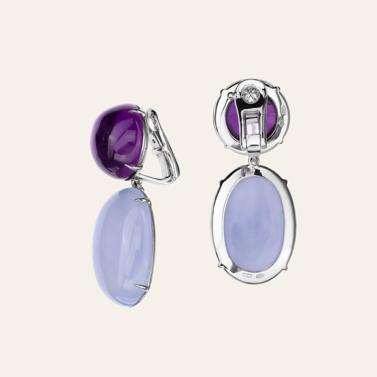 Sabbadini Cocktail Earrings With Amethyst And Chalcedony  18k White gold earrings, round cabochon amethysts 30,34ct and oval cabochon chalcedony 50,51ct. Gold 15gr Hand made jewelry & designed in Milan, in Via Montenapoleone. This item comes