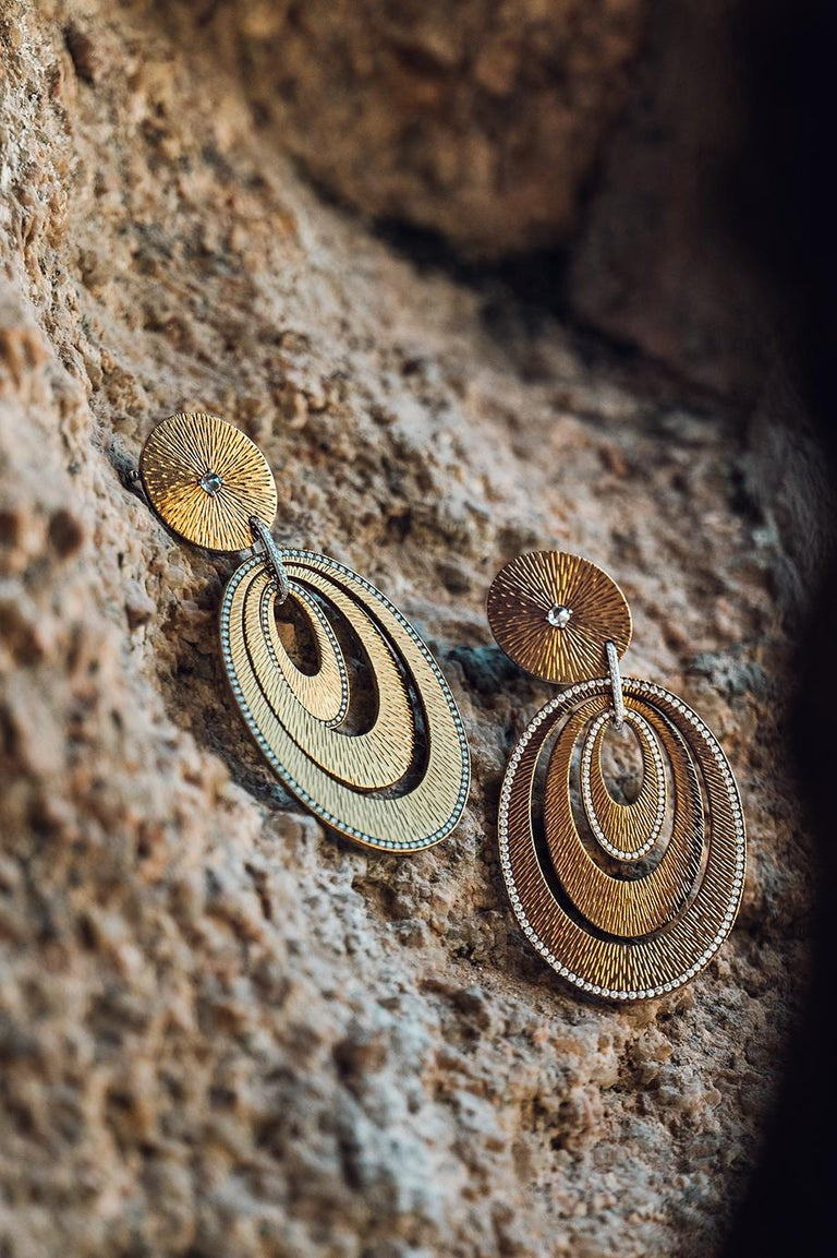 Sabbadini Contemporary Titanium, Gold & Diamond Earrings  Guilloché titanium and diamond micropavé pendant earrings. Diamonds 2,19 Carats The innovative use of titanium combined with precious stones, makes these earrings incredibly flexibile and