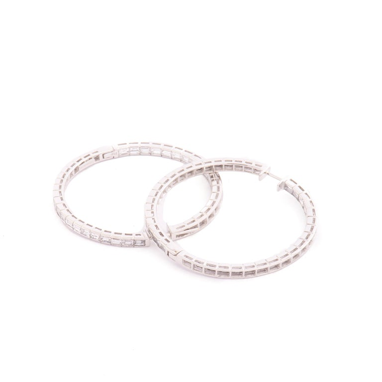 The perfect pair of 18kt gold and diamond hoops!  6,82 carats of white baguette cut diamonds F/G color, set inside and outside the hoop for maximum sparkle!