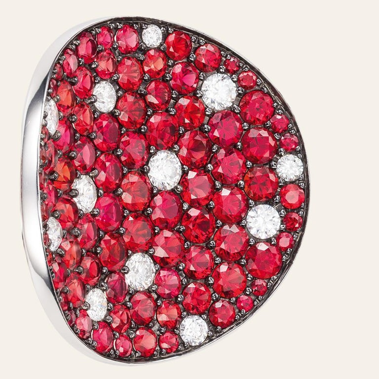 Sabbadini Red Sapphire & Diamond Round Earrings 18k White gold earrings, round cut red sapphires 9,98ct and round cut diamonds 1,37ct. Gold 28,56gr Hand made jewelry & designed in Milan, in Via Montenapoleone. This item comes directly from the