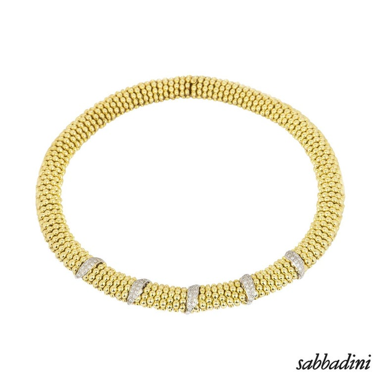 An 18k yellow gold diamond suite by Sabbadini. The suite consists of a bracelet, necklace and a pair of earrings pave set with round brilliant cut diamonds in a beaded ball design. The necklace features a total of 78 diamonds with an approximate