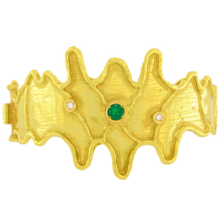 "Gorgeous Emerald and Diamonds Satin Yellow Gold Cuff Bracelet, from Sacchi's ""Abstract"" Collection, hand-crafted with lost-wax casting technique.  Lost-wax casting, one of the oldest techniques for creating jewelry, forms the basis of Sacchi's"