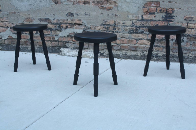 Handmade in Chicago by Laylo Studio, this solid walnut stool features turned and textured legs that are joined to the carved seat using wedged through tenons. The simple design showcases hand detailed relief cuts on the legs of the stool.  Shown in