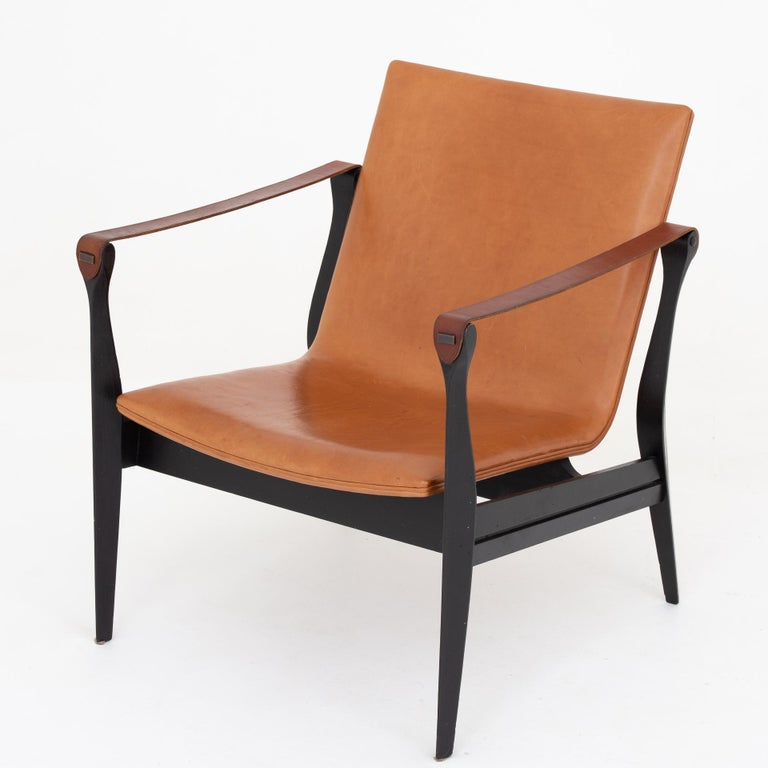 Model 4305, Safari chair in black ash with patinated cognac-colored leather. Maker Fritz Hansen.