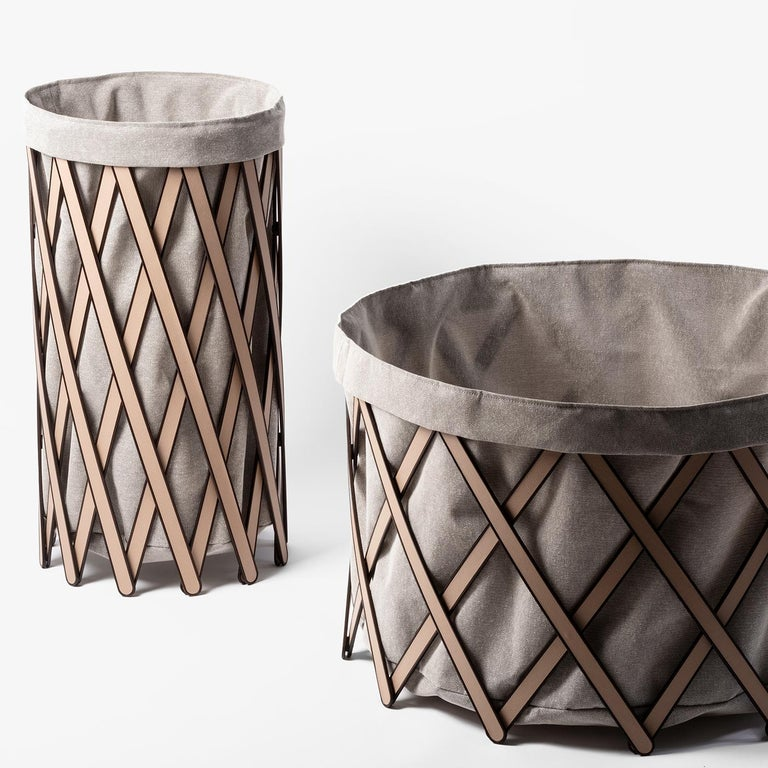 An elegant addition to any bedroom or bathroom decor, this foldable hamper boasts a stylish leather grid of flat wooden sticks covered with beige leather framing the natural canvas removable bag. Both frame and bag are available in other colors.