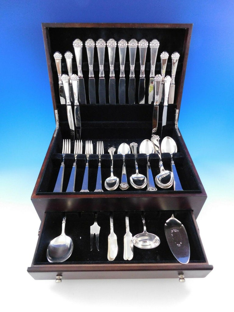 Superb Saga by Mylius Brodrene 830 silver Norwegian flatware set, 69 pieces. The company began in 1932 in Krager, in the south of Norway and closed its doors in 2008. This pattern has a pierced finial on a plain squared handle. This set includes:  8