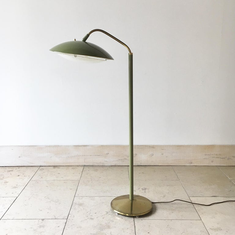 Sage green and brass floor lamp by Gerald Thurston for Laurel Lighting Company, 1950s.