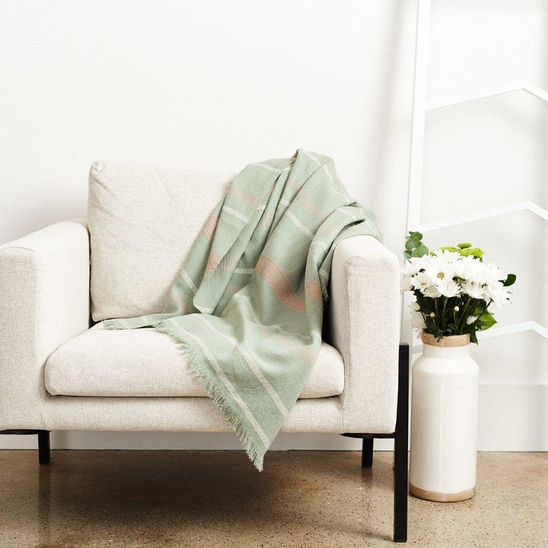 Custom design by Studio Variously, Sage is a organic cotton throw / blanket handwoven by master weavers in Nepal.  A sustainable design brand based out of Michigan, Studio Variously exclusively collaborates with artisan communities to restore and