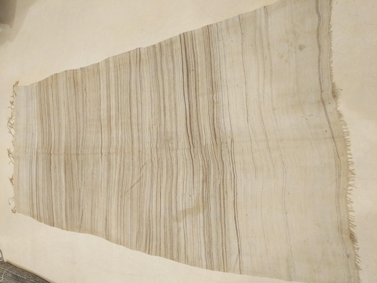 A spectacular flat-weave from the southern Moroccan Anti Atlas region, overlooking the Sahara desert. Indeed the pattern is suggestive of an aerial view of the desert, with the natural dunes created by the motion of the wind. These were originally