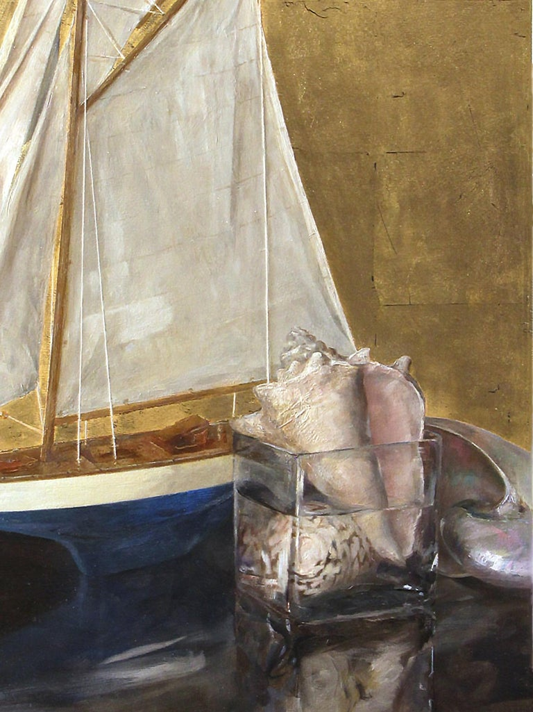Sumptuous gold leaf warms the background of this nautically themed still life. A model sailboat and a collections of seashells sit atop a reflective table. This masterful painting by artist Helen Oh evokes warm summer days and walks across the