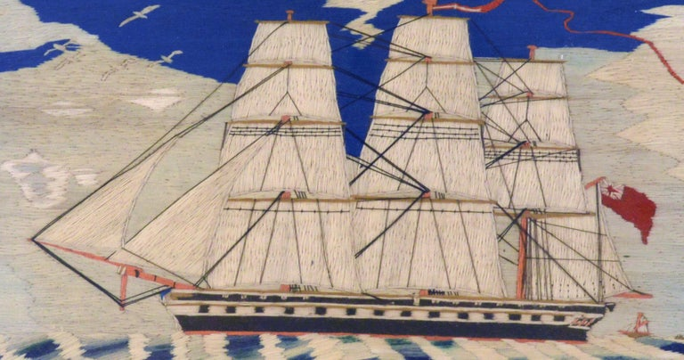Sailor's Woolwork of a Royal Navy Frigate, circa 1870-1880. (VM98341/IMRR)  A sailor's woolie picture of a portside view of a three-masted Royal Navy frigate under full sail flying a red ensign. In the far distance, beyond the stern, can be seen